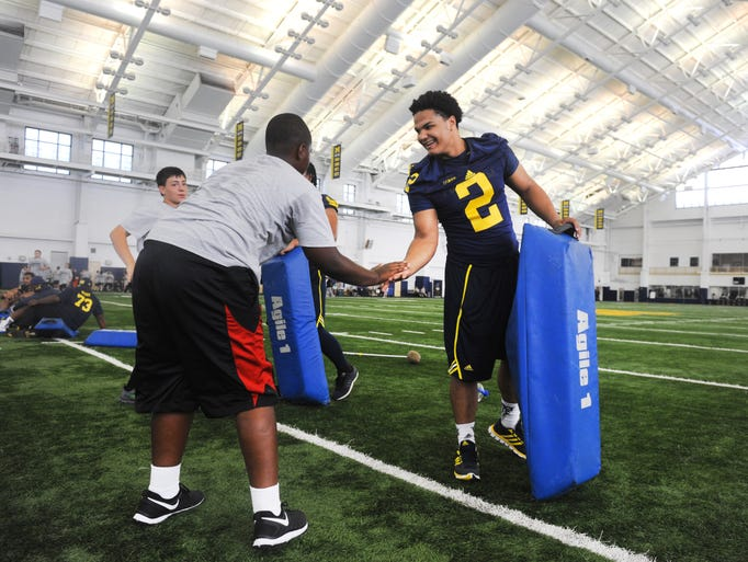 Michigan linebacker Carlo Kemp gets some respect during