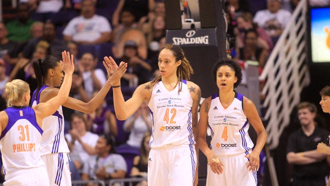 Mercury center Brittney Griner high fives her teammates after a block shot against Tulsa Shock during the second half at US Airways Center in Phoenix on Friday, June 20, 2014.