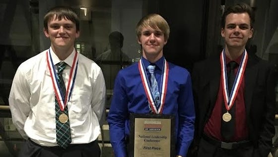 Lincoln students Brandon Mettler, left, Seth Morris and David Kniazevas received awards on stage at the National Leadership Conference of Business Professionals of America in Boston, Massachusetts.