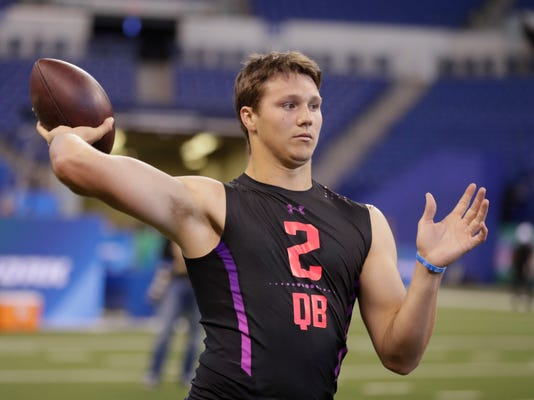 Wyoming quarterback Josh Allen runs a drill at the NFL football scouting combine in Indianapolis, Saturday, March 3, 2018. (AP Photo/Michael Conroy)