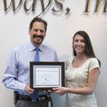 Pathways President and CEO Edward J. Lukomski presents Cynthia Gee with the employee of the quarter.
