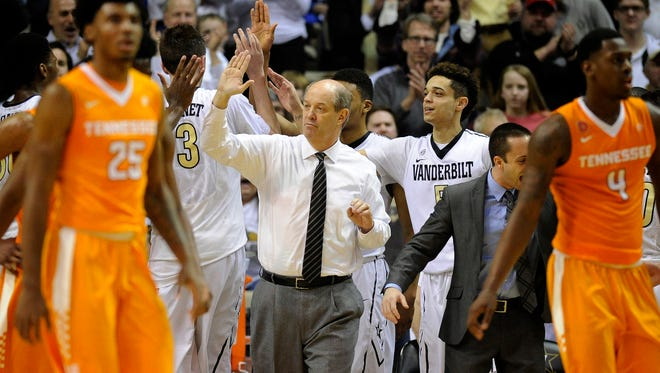 Vanderbilt coach Kevin Stallings celebrates with players during a timeout in the second half against Tennessee on March 1, 2016.