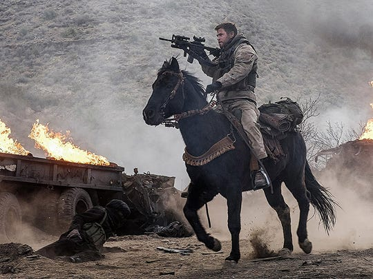 """Chris Hemsworth rides into battle in """"12 Strong."""""""