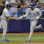 The Royals' Kendrys Morales, right, shakes hands with third base coach Mike Jirschele after hitting a two-run home run off Tampa Bay Rays starting pitcher Erasmo Ramirez during the third inning on Friday.