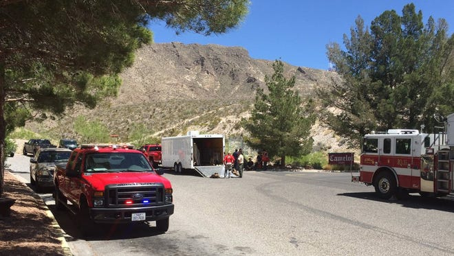 Rescuers on Saturday work to bring down an injured 49-year-old man from Franklin Mountains State Park. He was taken to a local hospital.