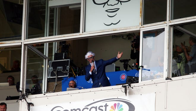 Jul 15, 2016; Chicago, IL, USA; Chicago Cubs former pitcher Ryan Dempster dresses up as Harry Caray while leading the 7th inning stretch of a baseball game against the Texas Rangers at Wrigley Field.