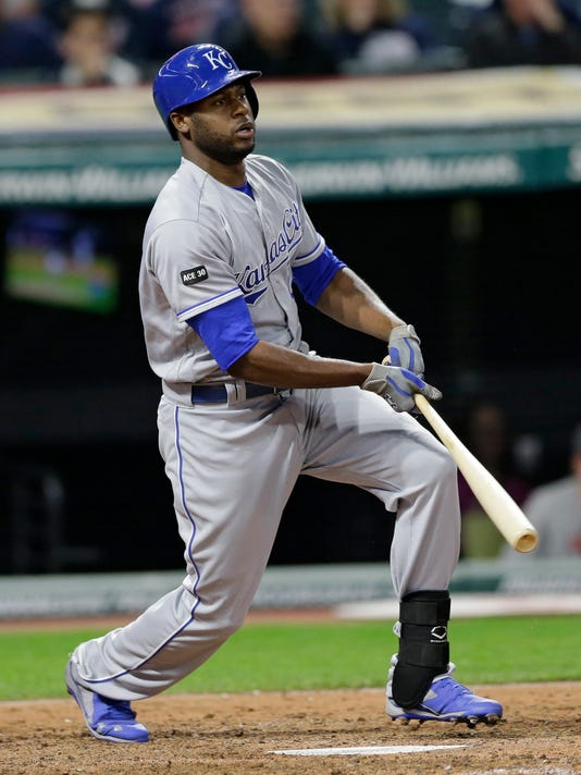 Kansas City Royals' Lorenzo Cain hits a single off Cleveland Indians relief pitcher Bryan Shaw in the eighth inning of a baseball game, Friday, May 26, 2017, in Cleveland. (AP Photo/Tony Dejak)