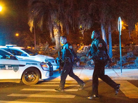 Police officers carrying assault rifles walk near Strozier library on the main campus of Florida State University on Nov. 20, 2014 in the aftermath of a shooting that left gunman Myron Mays dead.