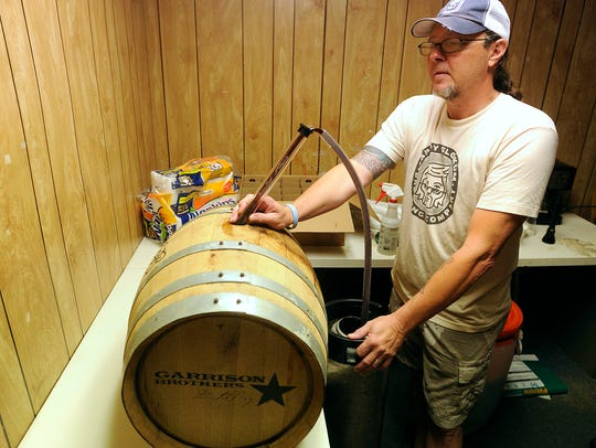 Pappy Slokum brewer and co-owner Jeff Bell fills up