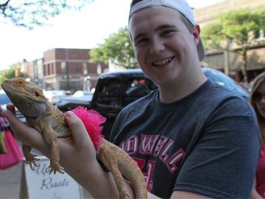 Yoshi, a bearded dragon, dressed in pink for the ninth-annual Pink Party in downtown Howell. Yoshi's owner, Keegan Collins, said it was important for Yoshi to show support for a good cause.