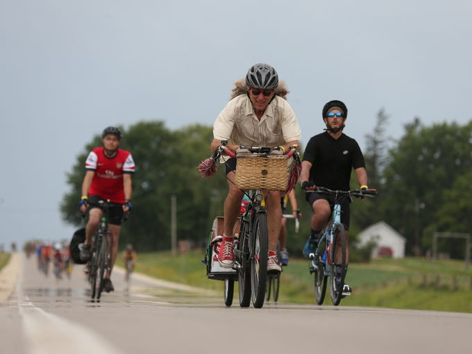 A rider coasts down a hill on Thursday, July 24, 2014, outside Waverly, Iowa.