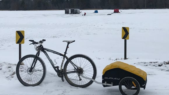 I use a Burley trailer to haul stuff when I need to run errands. This was a Christmas shopping trip. I was tempted to ride across the ice, but fear prevented me.