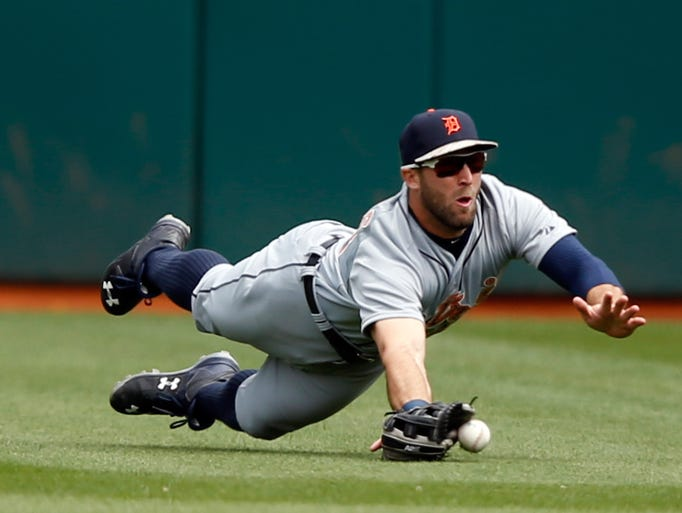 Detroit Tigers outfielder Tyler Collins  dives but