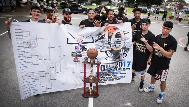 The A+ Bail Bonds team poses for a photo after winning the championship of the Sweep The Streets basketball tournament last year. The 11th annual event begins on Saturday at Southeast Playground in Lebanon.