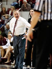 Mississippi State coach Vic Schaefer, left, voices