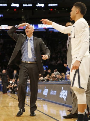 Xavier head coach Chris Mack reacts to an official's call during the final minutes of the semifinals of the Big East Tournament at Madison Square Garden in New York City Friday, March 11, 2016. Xavier lost 87-83.
