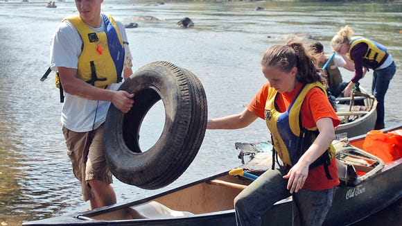 Volunteers unload trash collected from the French Broad River in a past Big Sweep River Cleanup. Nominations are being accepted by Land of Sky Regional Council for the Friends of the River Awards.
