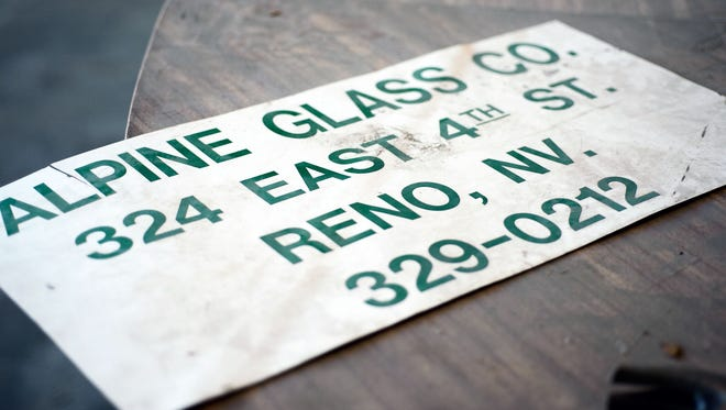 An old sign sits on the front counter.