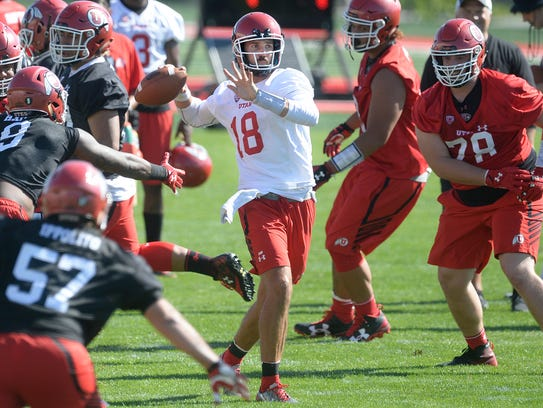 Utah quarterback Cooper Bateman looks to throw during