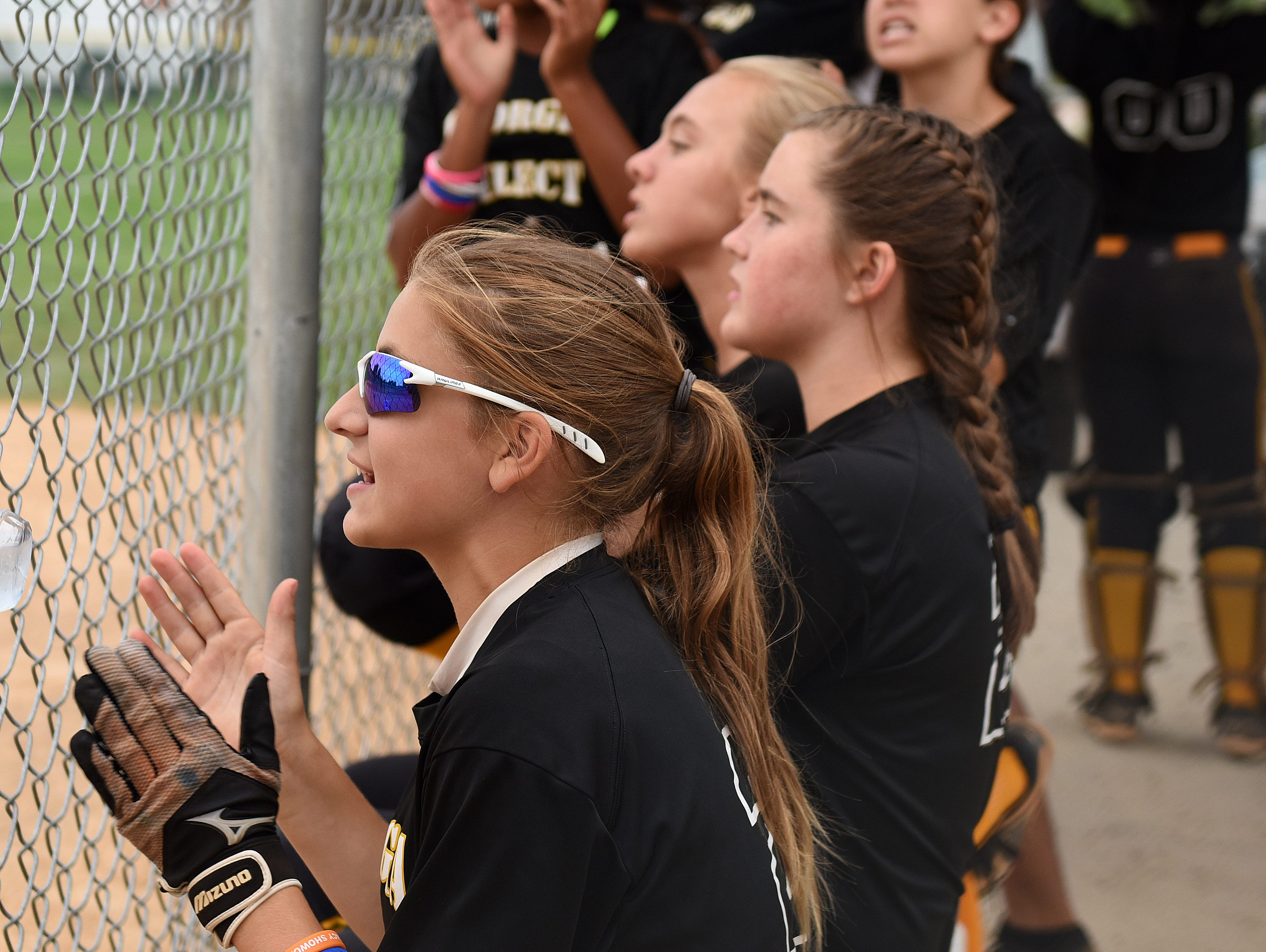 George Select chant as their team plays in the ASA 14U national softball tournament at Sherman Park in Sioux Falls, S.D., Monday, Aug. 1, 2016.