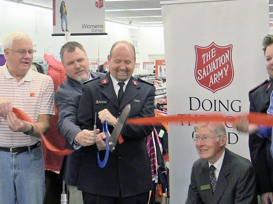 Major Kent Davis of the Salvation Army cuts the ribbon to open the new Family Store in Clemson on Friday.