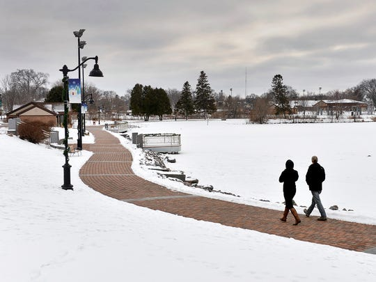 A snow-covered Lake George is conspicuously unusable for skating Friday, Jan. 8, 2016 as the warm winter made the lake more of a walking destination.