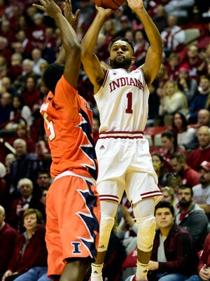 Indiana Hoosiers guard James Blackmon Jr. (1) shoots the ball over Illinois Fighting Illini guard Jalen Coleman-Lands (5) during the first half of  the game at Assembly Hall.