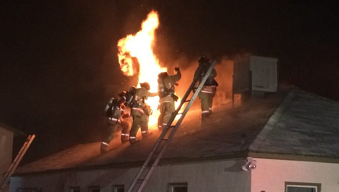 Firefighters cut a hole in the roof to extinguish a fire that broke out inside a Midtown home Wednesday night.