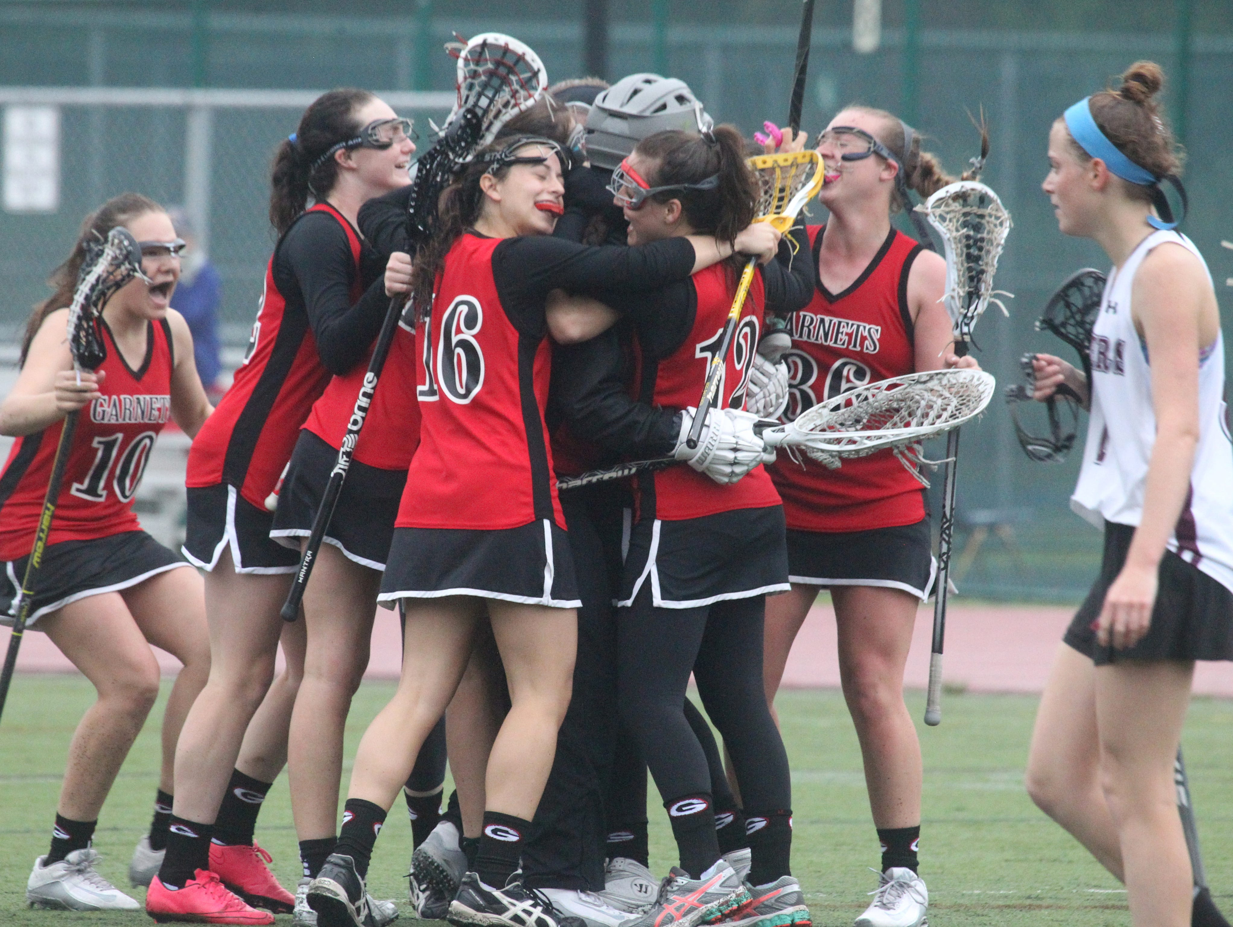 Rye players celebrate their 10-9 win at Scarsdale May 13, 2016.