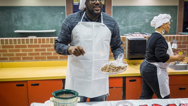 Malik Perry prepares a Mexican soup using a crockpot with Yolanda Taylor at the Unity Center in Muncie Thursday night.