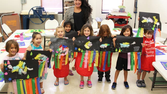 Young artists with instructor Raquel Gaudet.
