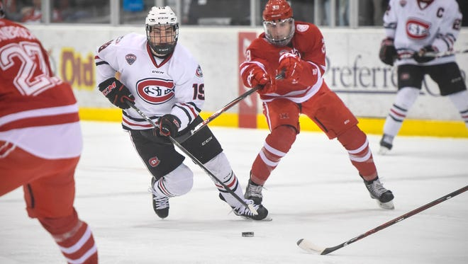 St. Cloud State's Mikey Eyssimont tries to get past Casey Gilling of Miami during the Saturday, March 10, game at the Herb Brooks National Hockey Center in St. Cloud.
