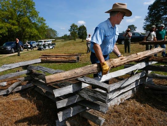 U.S. Interior Secretary Ryan Zinke builds a fence at