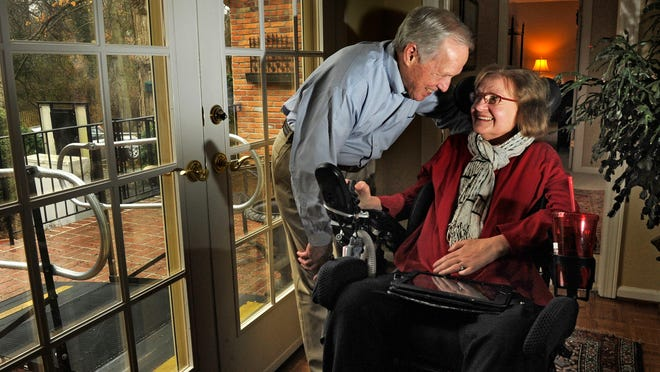 Marty Nord, who has had Lou Gehrig's disease for five years, talks with her husband, Larry Logan, in their Green Hills home.
