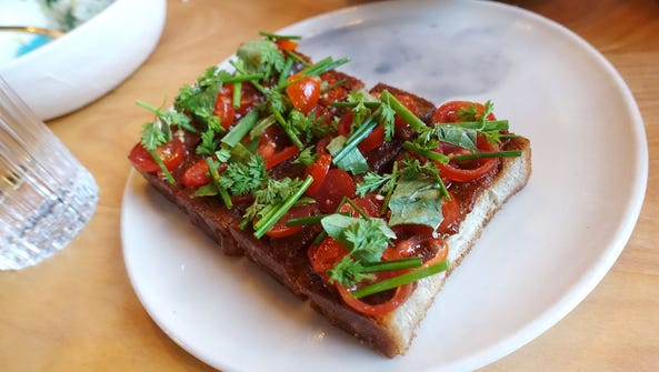 Tomato toast at Theodore Rex in Houston, Texas.
