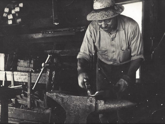 Samuel Outlaw is depicted at work in his blacksmith