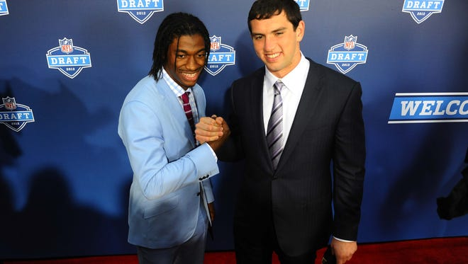 Andrew Luck (right) and Robert Griffin III were drafted No. 1 and No. 2 respectively in 2012, but now the two are going in different directions.