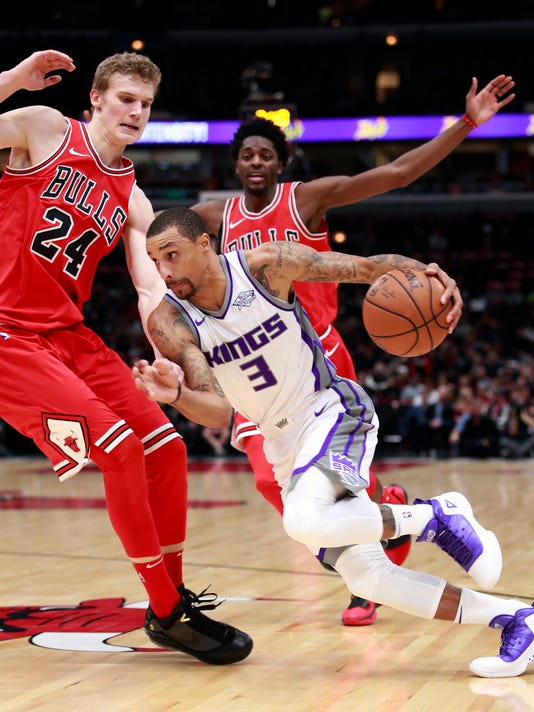 Sacramento Kings guard George Hill (3) dribbles past Chicago Bulls forward Lauri Markkanen (24) during the first half of an NBA basketball game in Chicago, Friday, Dec. 1, 2017. (AP Photo/Jeff Haynes)