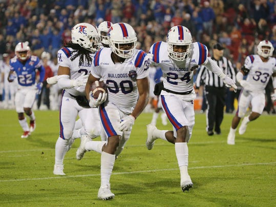 Louisiana Tech safety Darryl Lewis (38) runs 23 yards for a touchdown after intercepting an SMU pass during the second quarter of the Frisco Bowl NCAA college football game Wednesday, Dec. 20, 2017, in Frisco, Texas. (Andy Jacobsohn/The Dallas Morning News via AP)