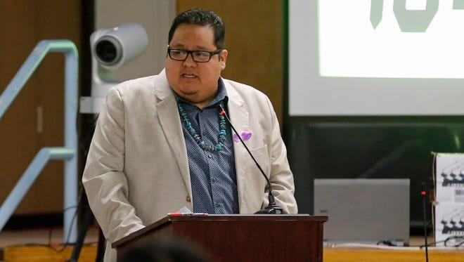 Navajo Nation Council Delegate Seth Damon addresses tribal lawmakers during the winter session on Monday in Window Rock, Ariz. Damon sponsored emergency legislation to provide supplemental funding to 33 Navajo Nation chapters for emergency services.