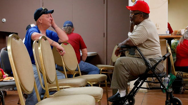 Veterans wait for their turn at a health care crisis center Tuesday in Phoenix.