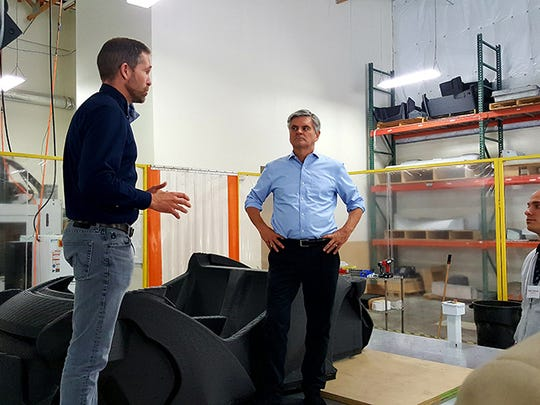 Steve Case (right) and Local Motors CEO John B. Rogers Jr. discuss the Phoenix company's production methods.