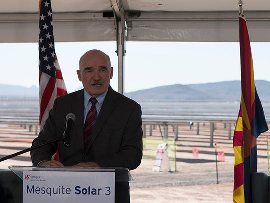 Assistant Secretary of the Navy for Energy Installations and the Environment Deniis V. McGinn speaks at the ceremony.