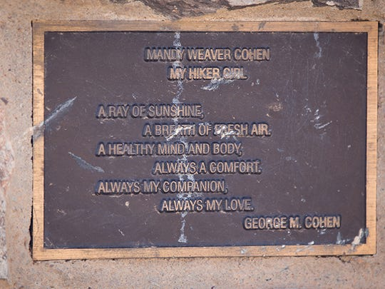 A plaque pays tribute to a hiker who has died.