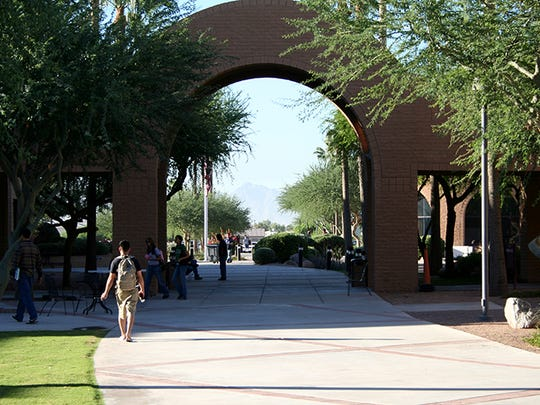 Students walk across campus at Estrella Mountain Community College, one of the campuses of the Maricopa Community Colleges. Estrella Mountain students, along with students from the other nine schools under the Maricopa County Community College District umbrella, will no longer be able to participate in their scheduled spring graduation ceremonies.