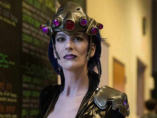 "Mary Brite, dressed as ""Widowmaker,"" is a professional prop maker in Phoenix. Many cosplay characters at the tournament were able to meet other versions of their own Overwatch game characters."