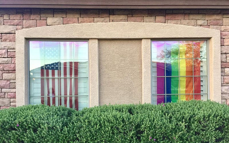 The American And Rainbow Flags Hang Side By Side Inside The Garage Windows  Of Bonnie Dalyu0027s Cave Creek Home. Her Homeowneru0027s Association Has Asked She  And ...