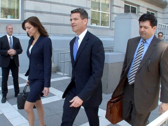 Former Port Authority Deputy Director Bill Baroni (center) leaves U.S. District Federal Court in Newark Monday.