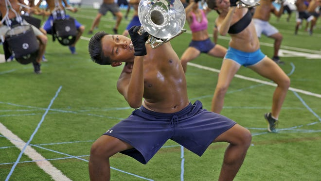 The Blue Devils rehearse for the Drum Corps International competition Thursday, Aug. 11, 2016.  They rehearsed at the Colts complex.
