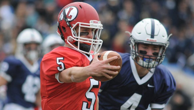 Lenape quarterback Matt Lajoie makes his way to the end zone, scoring on a 26-yard run late in the first quarter of Thursday's game against Shawnee.